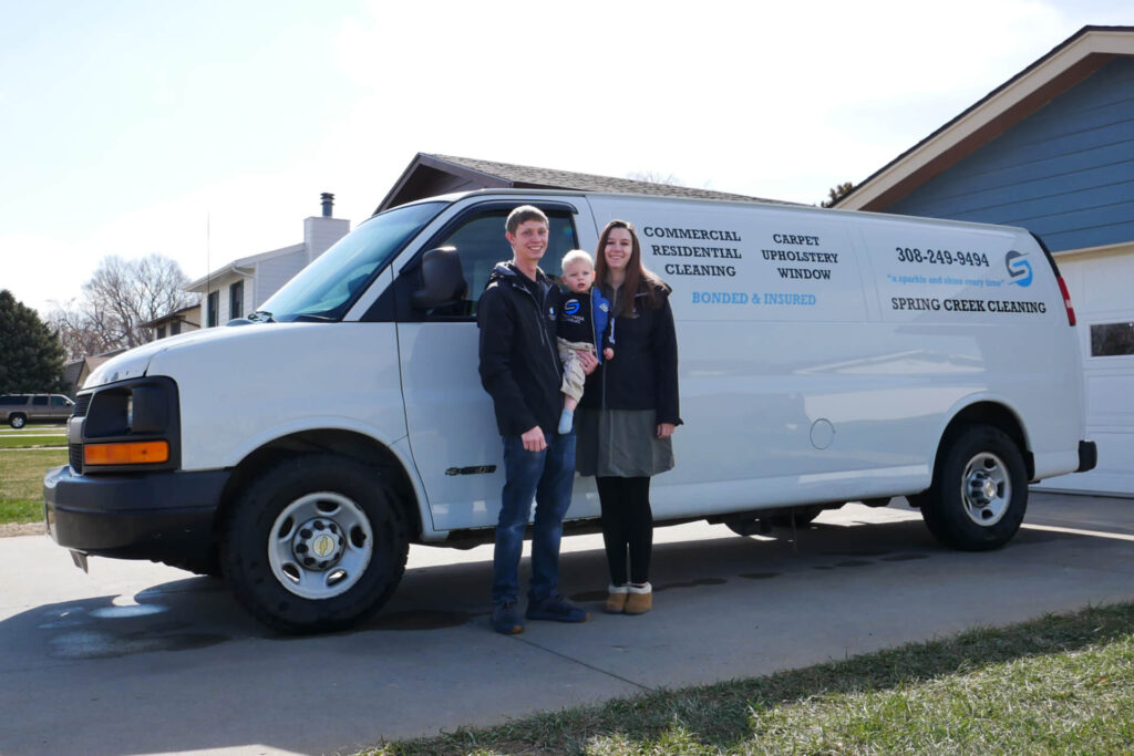 Megan and Montana DeNardo outside of there cleaning services van